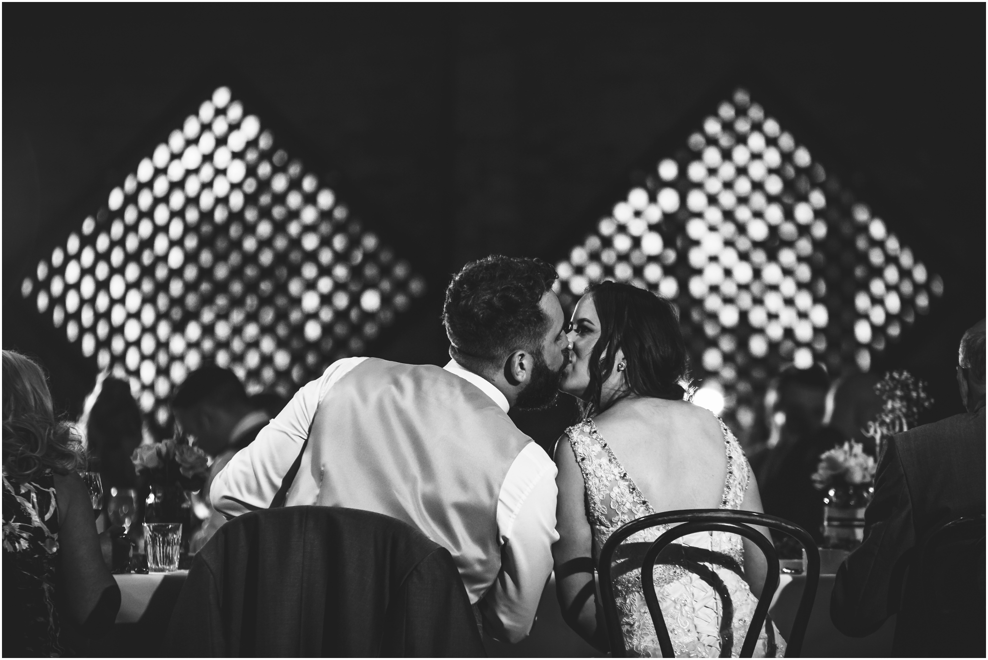 natural moment between bride and groom at Shustoke Farm Barn Wedding Photography