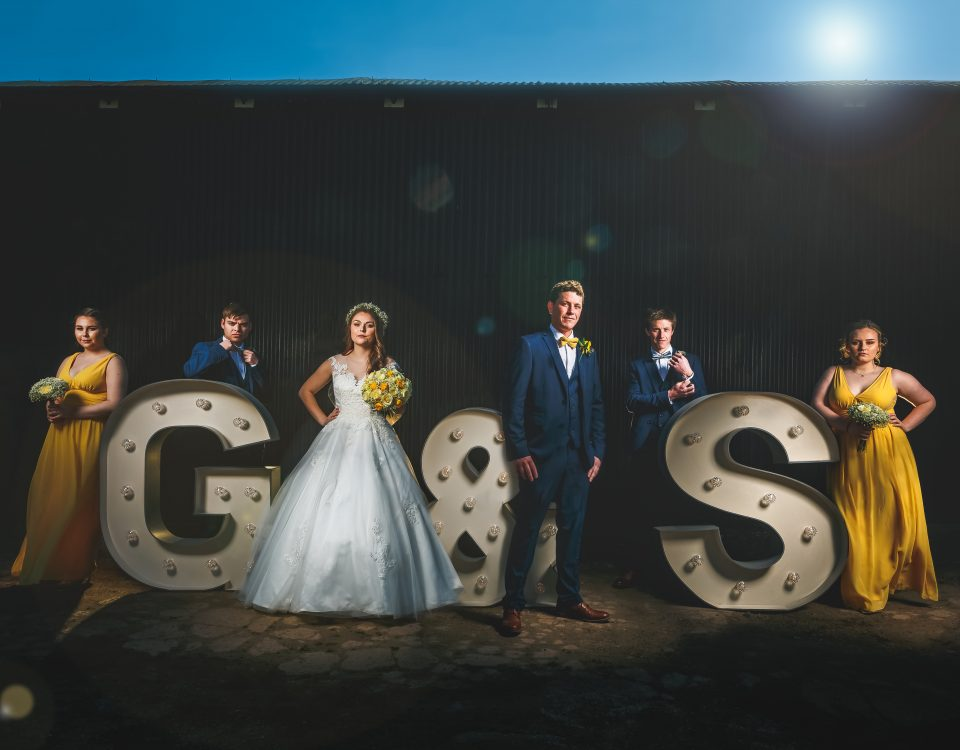 Composite shot using large letters for the bride and groom and their bridesmaids and groomsmen at Park Farmhouse, Castle Donington