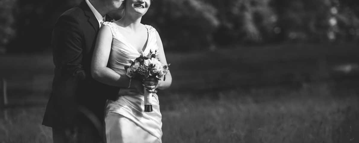 black and white portrait of newlyweds in the open fields surrounding Slaters Country Inn