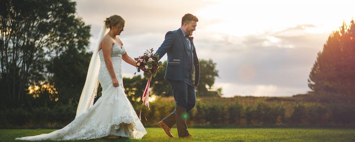rustic barn wedding sunset portraits