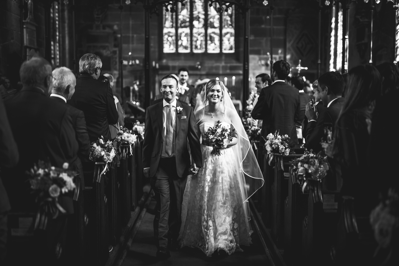 bride and groom aisle Gawsworth Hall Wedding Photography