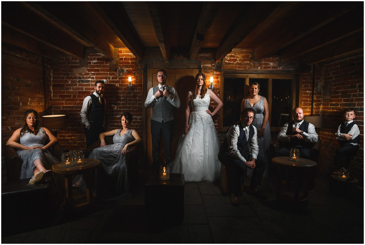 Bridal party posing for an epic barn wedding photography
