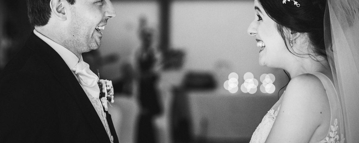 Black and white couple saying vows Sandhole Oak Wedding Photography