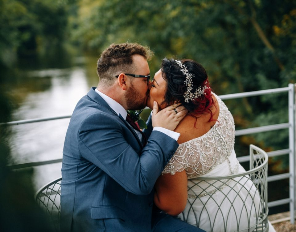 derbyshire industrial wedding venue newlyweds kissing the west mill