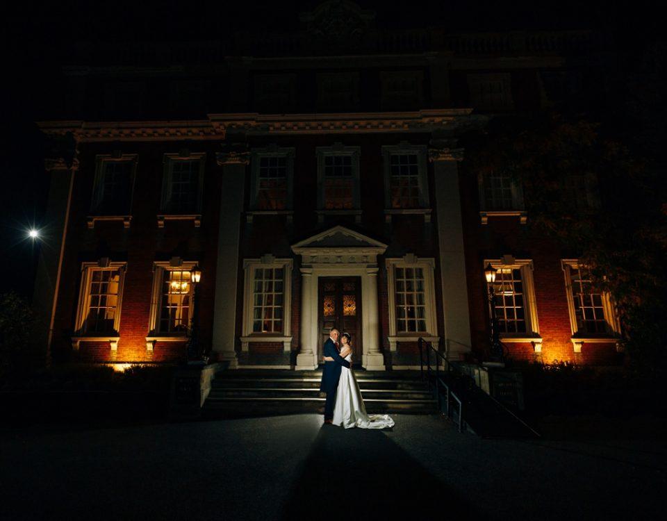 newlyweds outside swinfen hall wedding photography at night time
