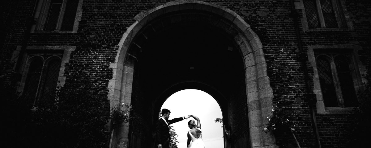 husband and wife dancing black and white hodsock priory wedding photography