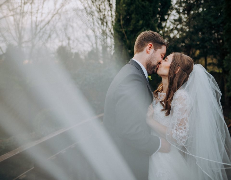 Veil newlyweds outdoor bridge shot branston country club wedding photography